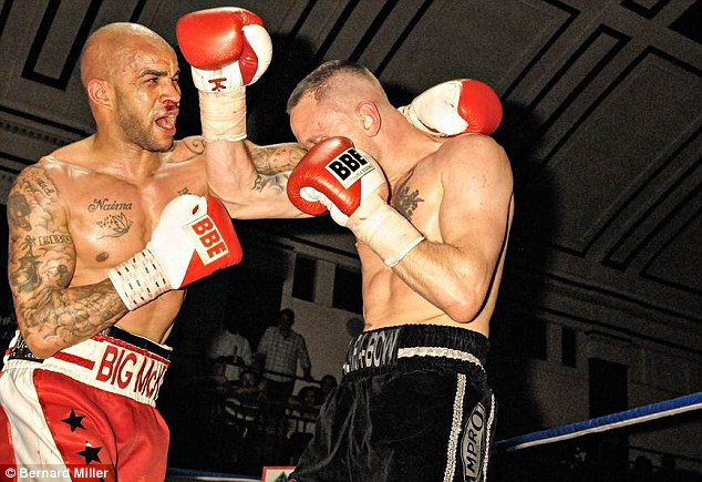 Battle royale: Brown has little defence to McKenzie's blows after being cornered on the ropes