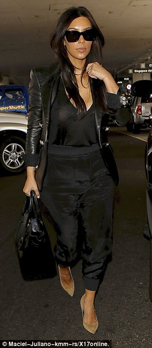 And the bride wore... The star donned an all-black look, featuring a slightly sheer black top with a pair of silk harem pants and a leather jacket