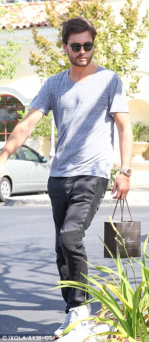 Off day: The 30-year-old dressed casually in a pair of black pants with a grey T-shirt and sneakers