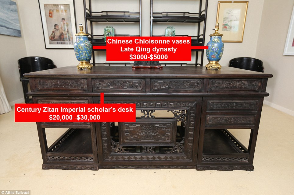 In comparison, this Chinese Zitan Imperial style scholar's desk also from the turn of the 19th century, is anticipated to go for $20,000 to $30,000 as oriental pieces are in high demand. It has been decorate with two gilt Chinese Cloissonne vases form the late Qing Dynasty, on sale for approx. $3,000-5,000