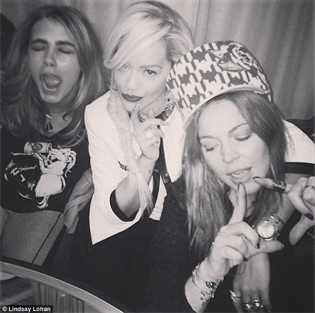 Cheers: She partied with supermodel Cara Delevingne and singer Rita Ora last week