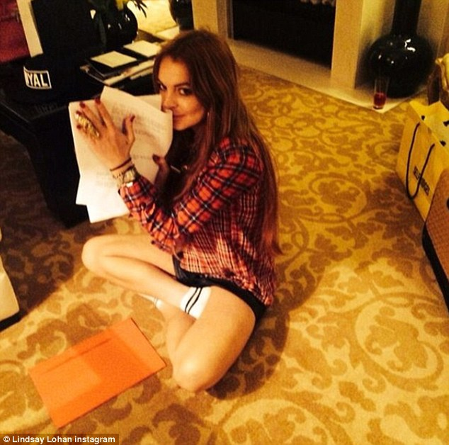 Not a sequel to Liz & Dick: She also shared a photo posing with a script in her hand