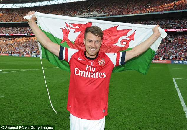Pride of Wales: Aaron Ramsey celebrates after scoring the winner for Arsenal