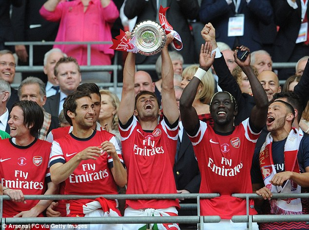 They've done it! The Arsenal players celebrate with the FA Cup
