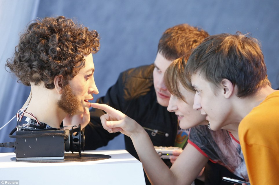 Robotical: A group of visitors check out the latest in artificial intelligence at the exhibition in the Russian capital
