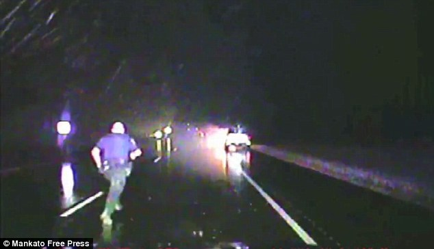 To the rescue: Dash-cam footage shows the moment a woman in southern Minnesota was rescued from her burning vehicle after getting trapped thanks to a lightening strike. Officer Chris Burdan seen running to the vehicle above