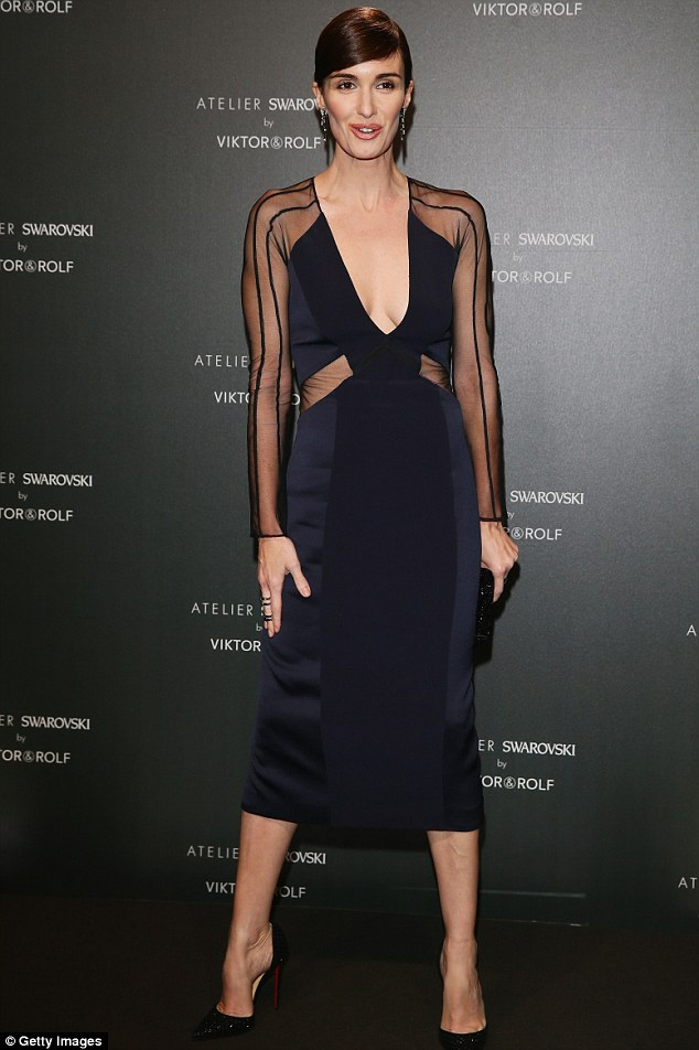 Turning heads: On Friday, the star had opted for a plunging navy dress to attend a party hosted by Swarovski and Viktor & Rolf during the 67th Annual Cannes Film Festival