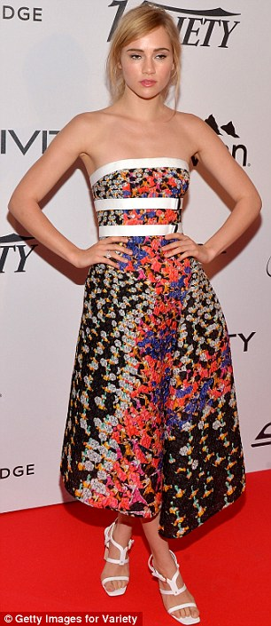 Fashionista: While Suki's number featured a voluminous skirt and white detailing on the bust and waist