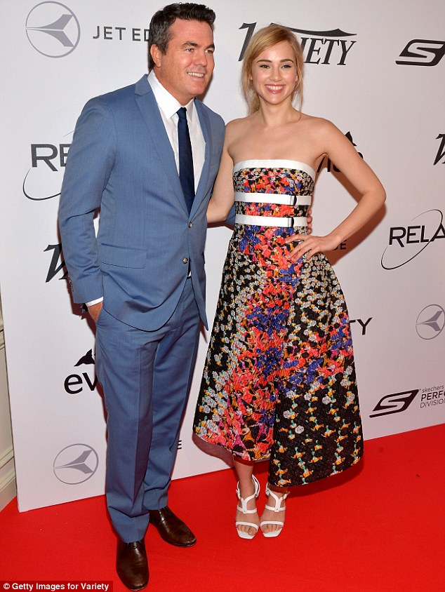 Arm-in-arm: The 22-year-old posed with Tucker Tooley, while keeping her long pins hidden under her eye-catching colourful dress
