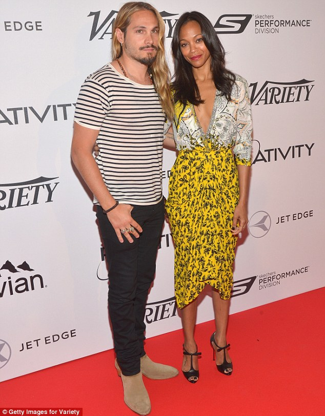 Smart-causal: The actress was accompanied by her husband Marco Perego, who was dressed much more relaxed than his wife in a striped T-Shirt and jeans