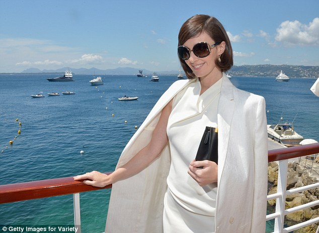 Nice view: The actress kept her sunglasses on as she posed in the sunshine while dressed all in white
