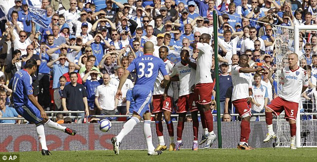 Precision: Chelsea striker Didier Drogba wins the 2010 FA Cup with a perfectly placed free-kick against Portsmouth