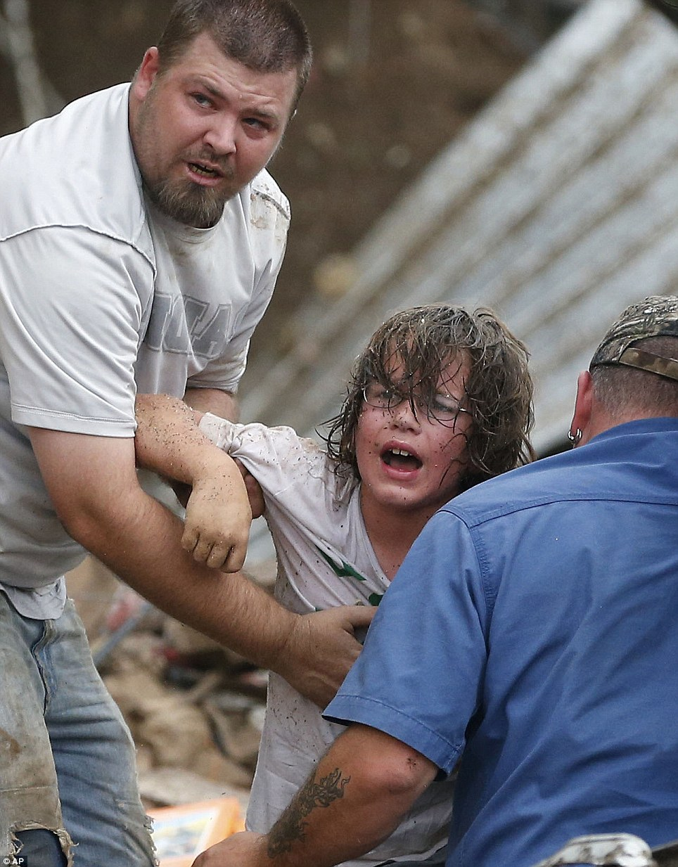 Horror: A child calls to his father after being pulled from the rubble of the Tower Plaza Elementary School following a tornado in Moore, Oklahoma