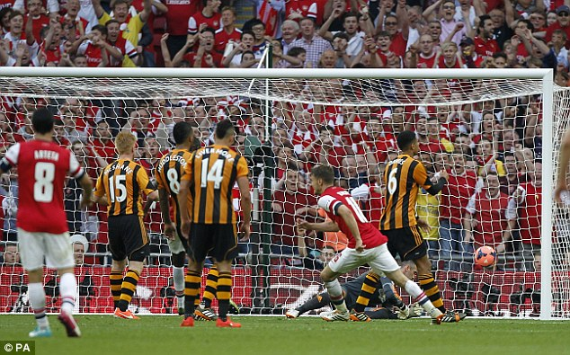 Matchwinning moment: Aaron Ramsey (second right) scored the winner for Arsenal in the 109th minute vs Hull