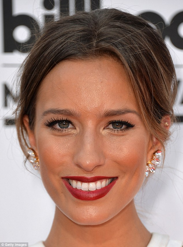 Lighting up: A close up shot revealed her beautiful complexion highlighted with cardinal red lipstick and a cheery smile