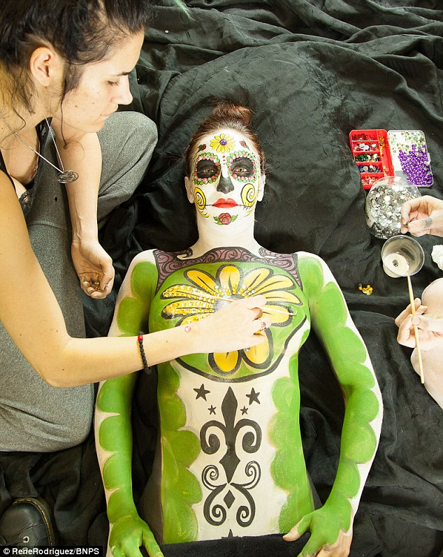 When the models all get into position they form a perfect sugar skull - the brightly coloured icon of the Day of the Dead festival, a Mexican tradition