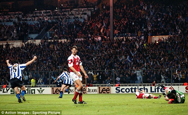 Contrast: Chris Waddle celebrates as Tony Adams looks on during the 1993 FA Cup final replay