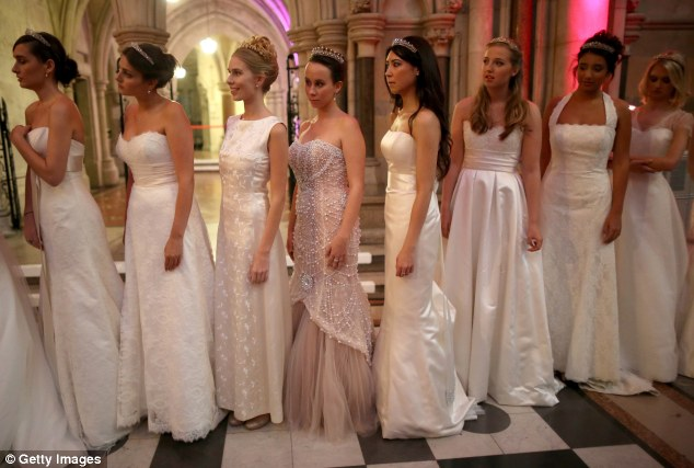 Belles of the ball: Young debutantes wait in line at the Queen Charlotte's Ball last year