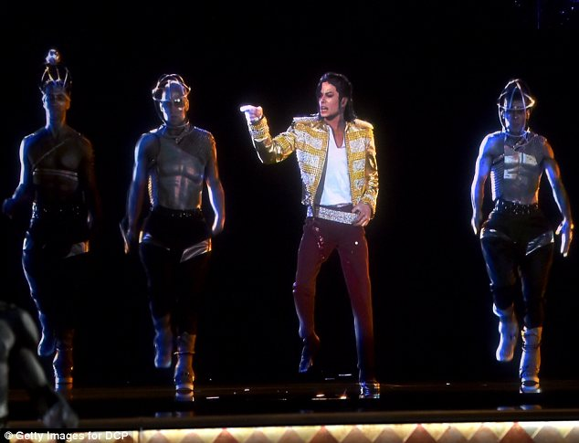 Amazingly realistic: The hologram even did the moonwalk while dancers were beside it, and fire shot out around it