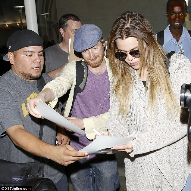 Pleasing the crowds: Khloe signed autographs for fans
