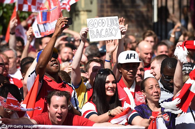 Gesture: Arsenal fans are keen for Sagna to stay, but it looks as though he's played his final game for the club