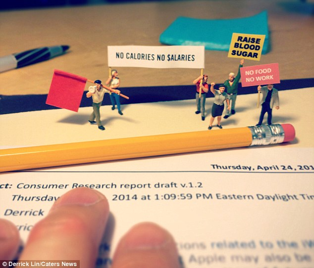 When hunger strikes: Mini figurines make their point on Mr Lin's desk