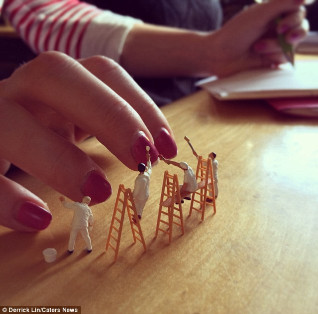 Nail salon... who has time for that? Mini figurines paint the nails of a colleague on Mr Lin's desk