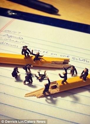 Mini figurines replicate a scene from 2001 A Space Odyssey, on Derrick's desk
