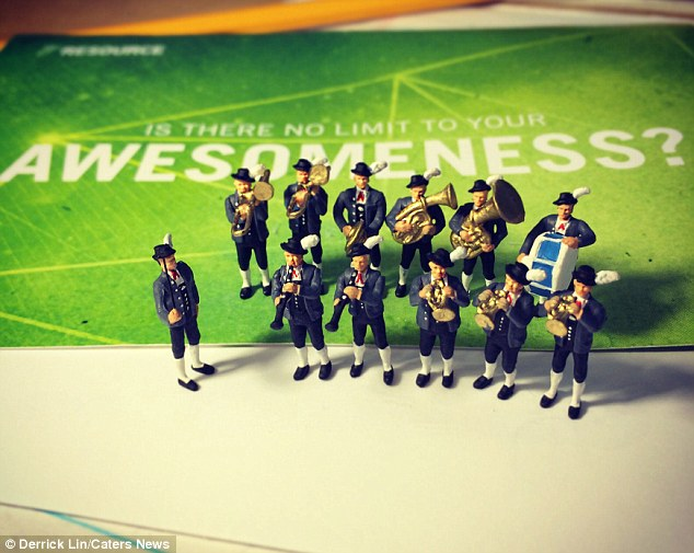That moment when you get a pat on the shoulder: Brass band figurines mark the occasion
