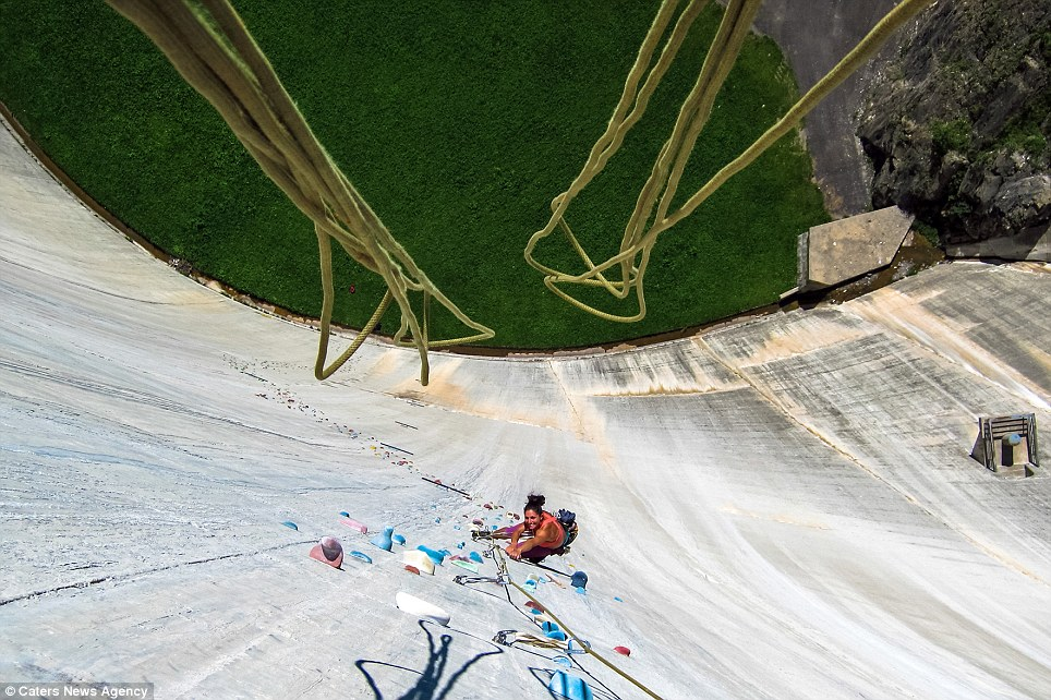 Long way down... The 540ft-high dam in Switzerland that thrill-seekers have turned into a climbing wall