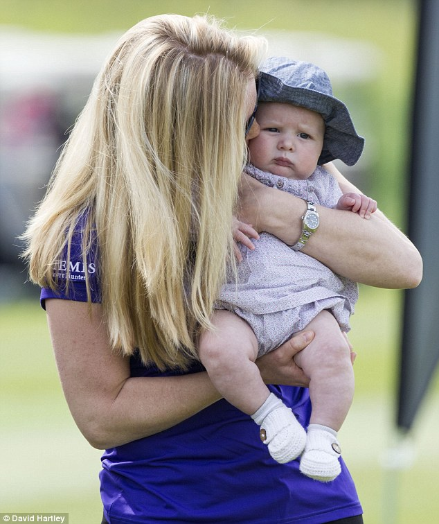 Cuddles: Autumn relished her time with the four-month-old