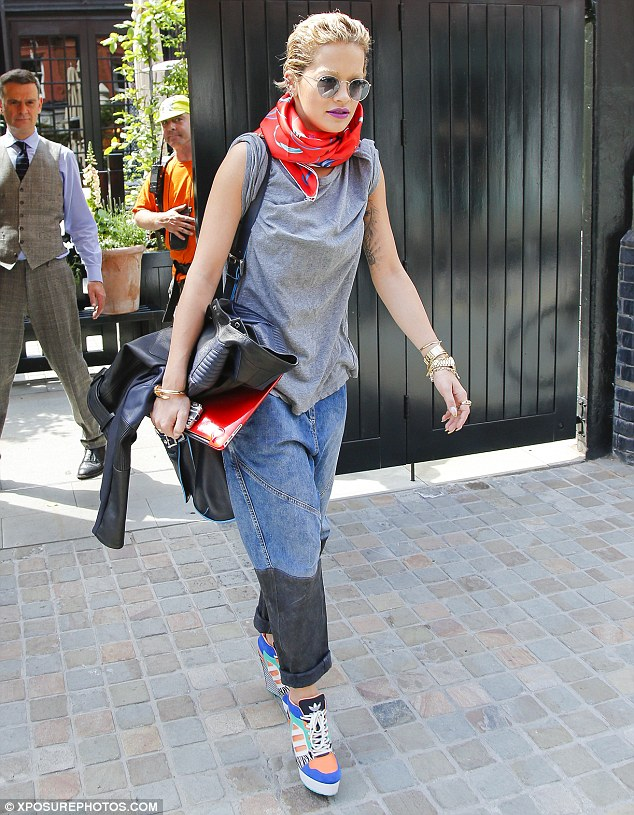 Cowgirl: Rita Ora proved that her work ethic is second to none as she made her way to a London studio on Monday afternoon