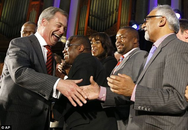 Amjad Bashir, the party¿s small and medium size business spokesman, is pictured shaking Mr Farage's hand after telling the rally: ¿Take a look at all the faces and skin colours represented on this stage and tell me Ukip is a racist party'