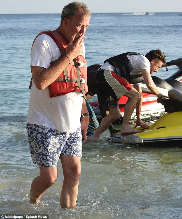 Chilling out: Jeremy Clarkson lights up on a Barbados beach as he and his Top Gear chums enjoy some down time as filming wrapped on Sunday
