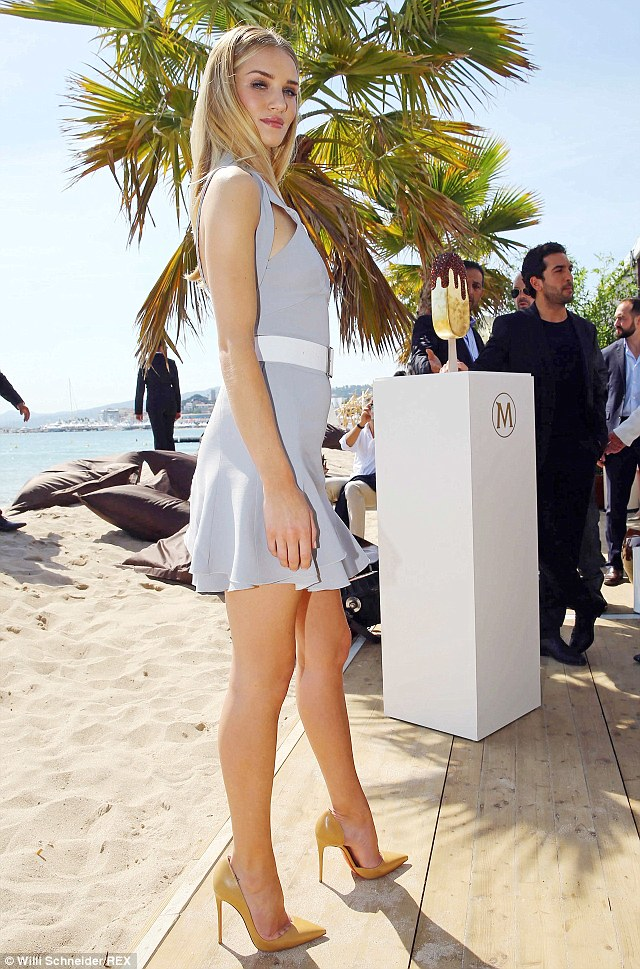 Beach side beauty: Rosie looked gorgeous posing next to the beach in Cannes