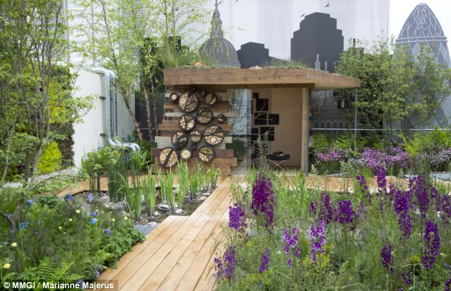A bird hide with wildlife habitats on the walls can double as a high-rise workspace