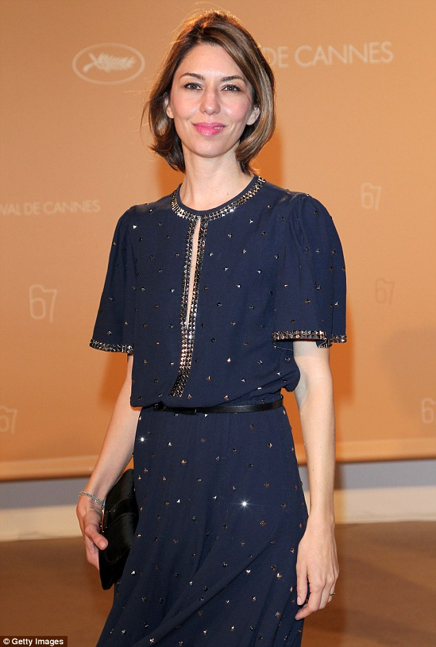 Effortlessly elegant: Critically-acclaimed screenwriter/producer/director Sofia Coppola - who is also a member of the feature films jury - looked stylish as always in her midnight blue dress, her cropped brunette tresses worn in a simple, no-fuss style, her make-up fresh and dewy with glossy pink lips