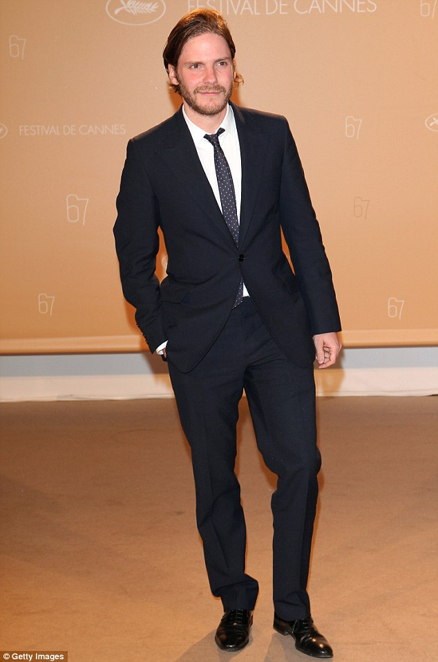 Suited and booted: Spaniard Daniel Brühl looked suave in his dapper black suit as he drummed up interest in his upcoming project, Alone In Berlin, co-starring Emma Thompson