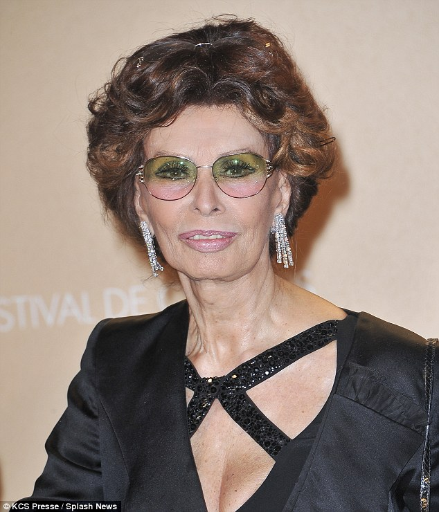 Ready for her close-up! The 79-year-old Oscar-winner wore her signature rose-hued glasses, while she had another pair of reading specs sat atop her mass of trademark dark red curls, while her face was beautifully made up in complementary tones, accented by dangly diamond earrings