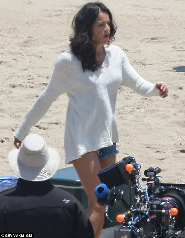 Life's a beach: The Latina lovely seemed to be enjoying the chance to enjoy a day out at the seaside