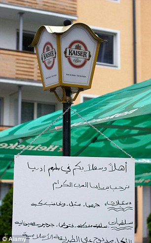 Arabic sign: A post in Zell am See in Salzburg where leaflets are being handed out to Arab tourists