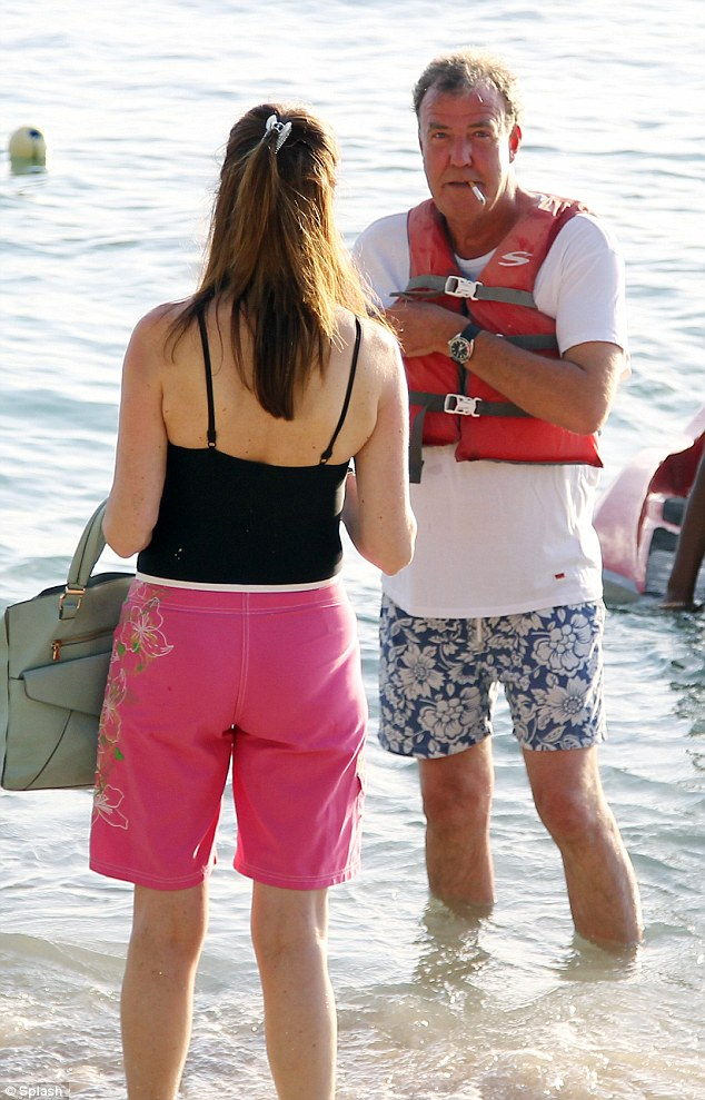 Are you that guy from the telly? Clarkson puffs merrily away as he chats to fans and locals who spot him relaxing on the beach
