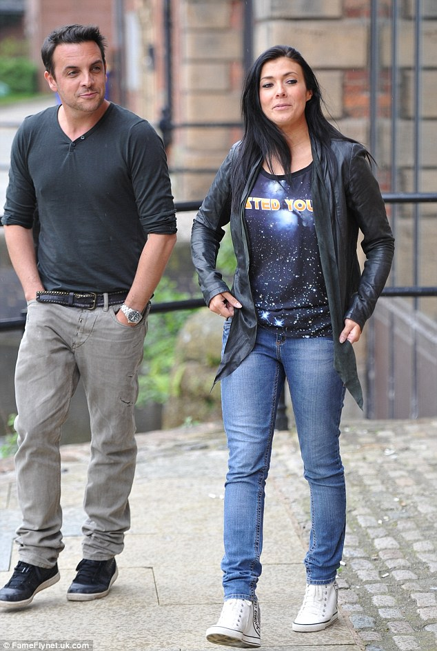 Good spirits: Kym was seen in outside the radio studio chatting with a friend