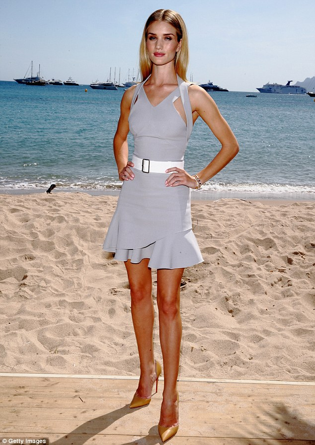 Striking a pose: Rosie showed off her model physique in the futuristic grey dress for the photo call