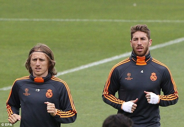 Ready to go: Sergio Ramos and Luka Modric train ahead of the Champions League final