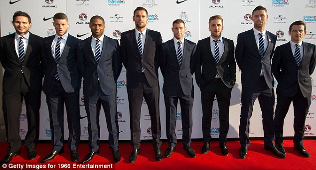 Well suited: England stars (from left) Frank Lampard, Ross Barkley, Glen Johnson, Ben Foster, James Milner, Luke Shaw, Gary Cahrll, Leighton Baines on the red carpet at Lions and Roses