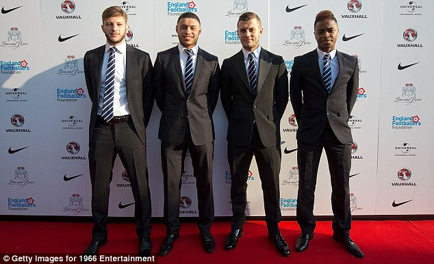 Understanding their roles: The squad including (from left) Adam Lallana, Alex Oxlade-Chamberlain, Jack Wilshere and Raheem Sterling helped raise a lot of money