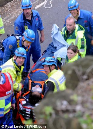 A 33-year-old Romanian immigrant had to be rescued after falling off a cliff in his sleep