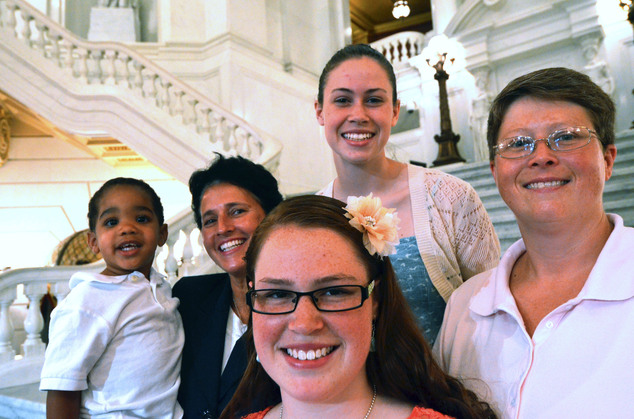 Plaintiffs: In this July 9, 2013 file photo, the Whitewoods, left to right, Landon, Susan,  Abbey, Katie, and Deb, pose together after a news conference to announce that Deb and Susan are the lead plaintiffs in a lawsuit to overturn a state law effectively banning same-sex marriage in Pennsylvania