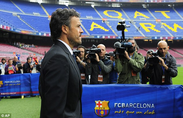 Welcome back: New Barcelona boss Luis Enrique makes his way on to the Nou Camp pitch